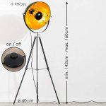 Lampadaire tripode Saturn XL noir avec réflecteur doré - Lampadaire projecteur de cinéma avec globe pivotant et hauteur ajustable - Luminaire design vintage adapté aux ampoules LED de la marque hofstein image 1 produit